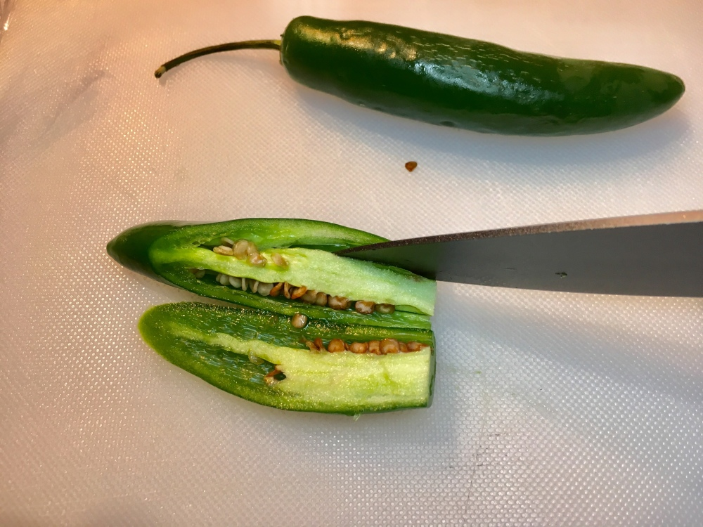 cutting hot peppers for avocado salsa verde